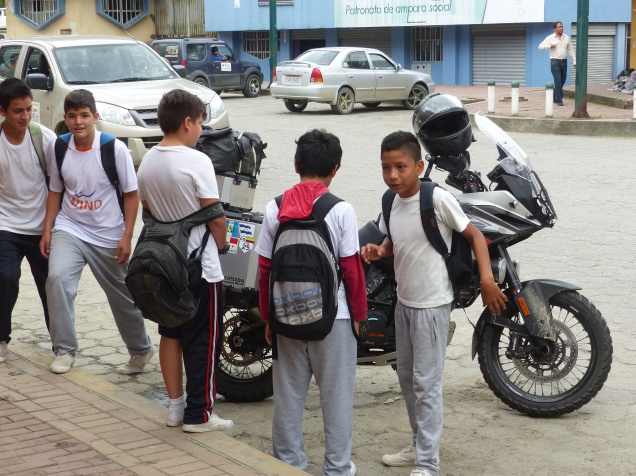Boys inspecting the bike